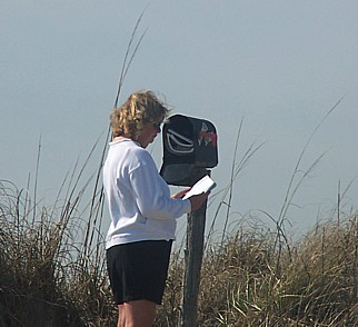 Woman reading journal from Kindred Spirit Mailbox